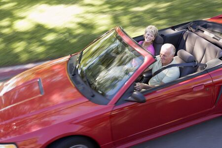 Couple in convertible car smiling Stock Photo - 3475873