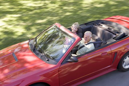 Couple in convertible car smiling Stock Photo - 3475884