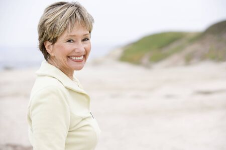 Woman at the beach smiling photo