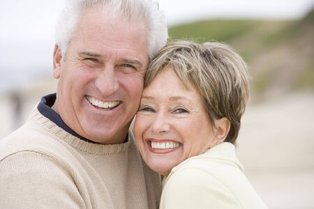 Couple at the beach smiling photo
