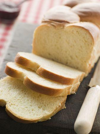 Brioche Loaf Sliced on a Chopping Board photo