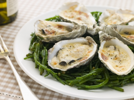 Grilled Oysters with Mornay Sauce on Samphire photo