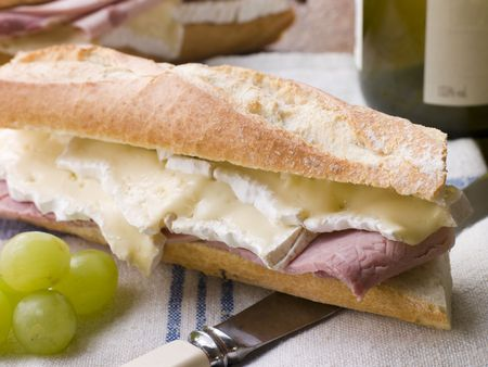 hero sandwich: Brie and Ham Baguette with White Wine and Grapes