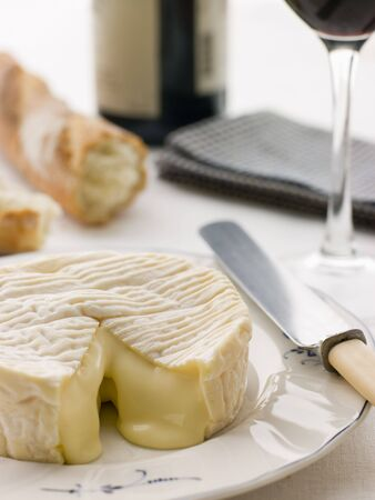 camembert: Round of camembert cheese with French stick and Red Wine Stock Photo