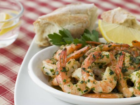 Dish of Garlic Buttered Tiger Prawns with Rustic Bread photo