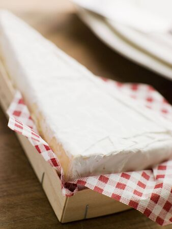 brie: Wedge of Brie in a Wooden Box