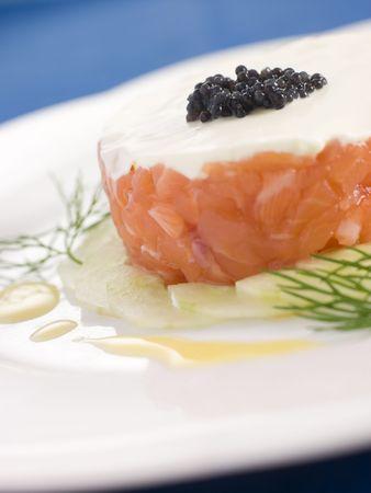 tartare: Tartare of Wild Salmon Creme Fraiche Cucumber Caviar and Lemon Oil Stock Photo