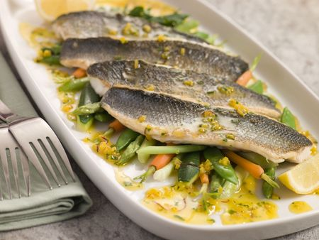 Fillets of Sea bass with  Vegetables and Saffron Butter photo
