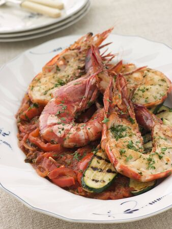 courgettes: Grilled Tiger Prawns on Piperade with Grilled Courgettes Stock Photo
