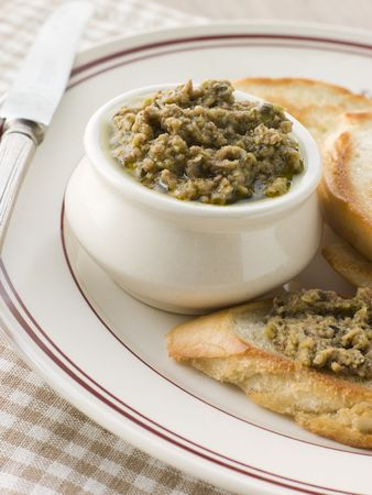 toasted: Green Olive Tapenade with toasted baguette Stock Photo