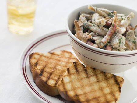 fricassee: Fricassee of Frog Legs with Grilled Brioche