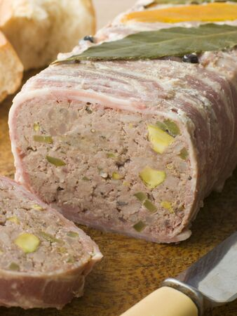 campagne: Pate Campagne on a Chopping Board with Rustic Bread Stock Photo