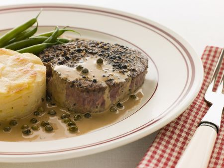 Filet Mignon au Poirve with French Beans and Pomme Anna photo