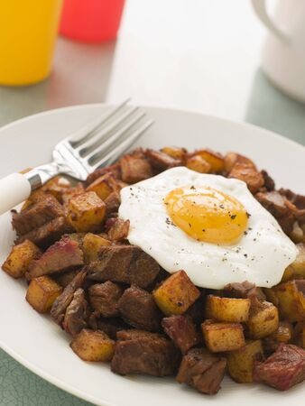 Corned Beef Hash With a Fried Egg and Black Pepper photo