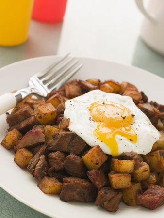 tomato catsup: Corned Beef Hash with a Broken Fried Egg and Black Pepper