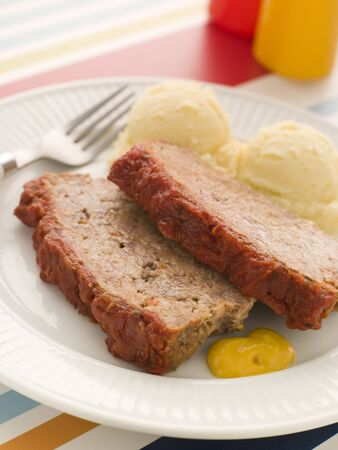 tomato catsup: Meatloaf Baked in Tomato sauce with Mashed Potatoes and Mustard