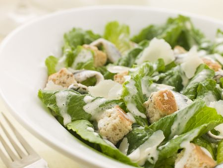 salad fork: Bowl of Caesar Salad Stock Photo