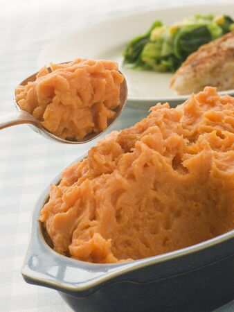 mashed potatoes: Dish of Sweet Potato Mash with a spoon