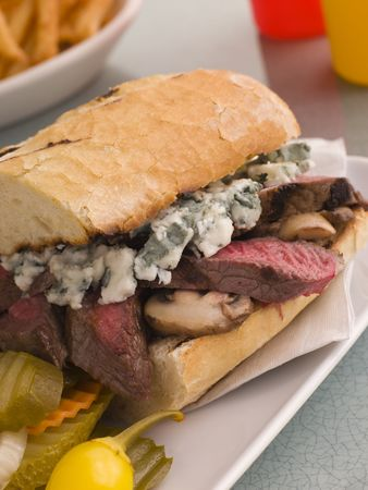 hoagie: Steak and Roquefort Sandwich with Fries Gherkins and Chillies