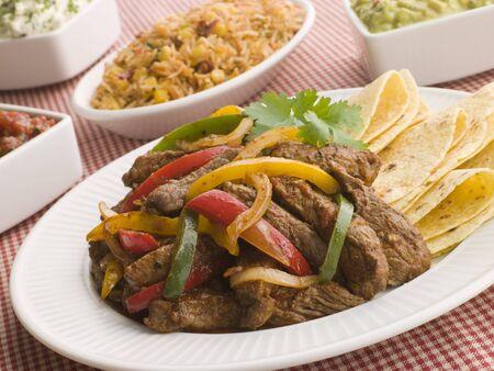 guacamole: Steak Fajitas with Jambalaya Guacamole Salsa and Sour Cream