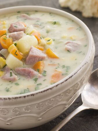 chowder: Bowl of Bacon and Corn Chowder with Soda Bread Stock Photo