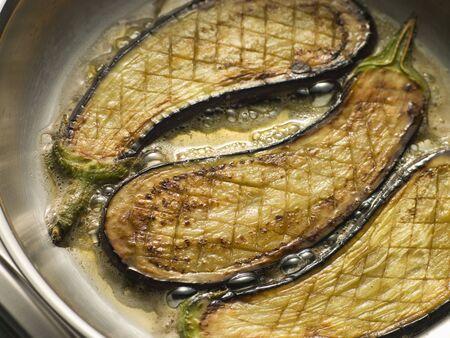Eggplant Frying in Corn Oil Stock Photo - 3443881