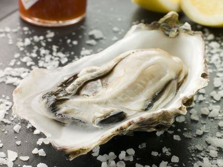 sel: Opened Rock Oyster with Hot Chilli Sauce Lemon and Sea Salt