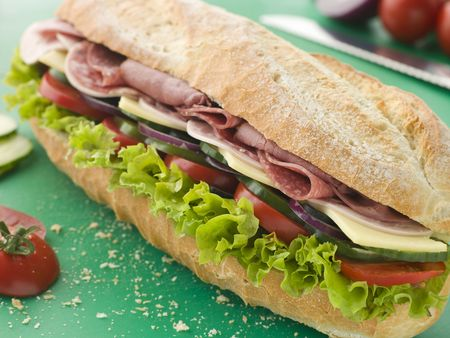 Deli Sub Sandwich on a Chopping Board photo