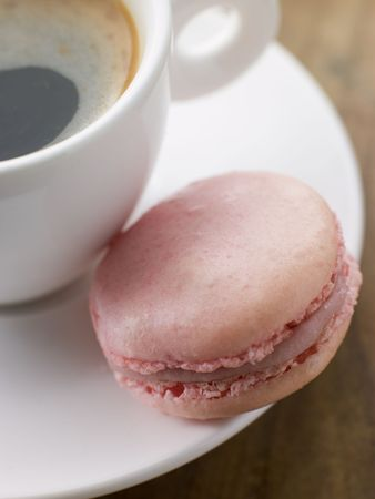 Raspberry Macaroon with a Cup of Espresso Stock Photo - 3443393