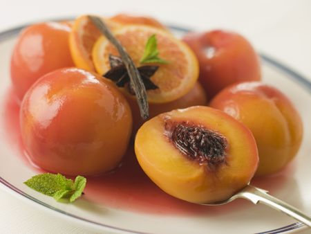 Bowl of Peaches Poached in Sauternes Wine photo