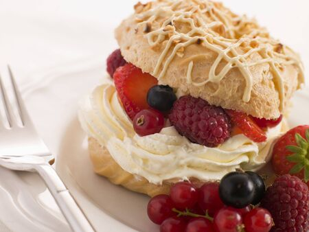 Choux Bun filled with Mixed Berries and Chantilly Cream photo