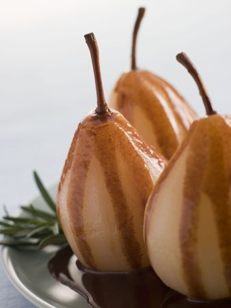 Pear Poached with Rosemary and a Chocolate sauce Stock Photo - 3443422