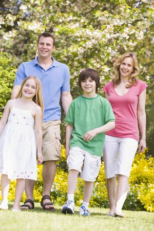 Family walking outdoors smiling Stock Photo - 3476184