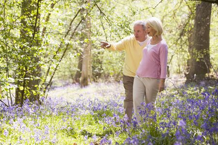 oap: Couple walking outdoors pointing and smiling