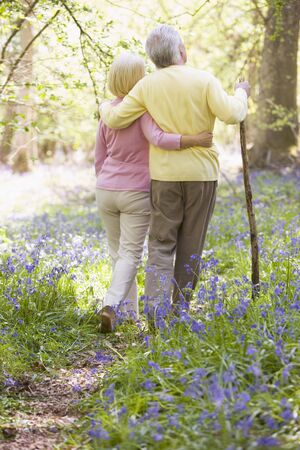 bluebell woods: Couple walking outdoors with walking stick