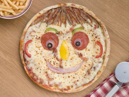 Smiley Faced Pizza with a Portion of Chips photo