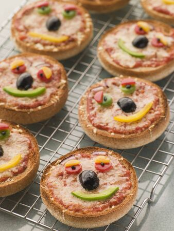 childrens food: Smiley Faced Pizza Muffins Stock Photo