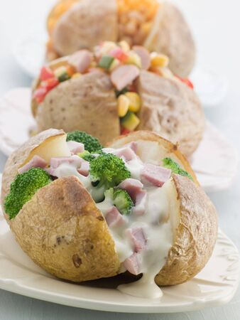 Baked Potatoes with a Selection of Toppings Stock Photo - 3444185