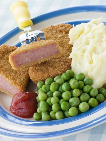 tomato catsup: Breadcrumbed Luncheon Meat with Mashed Potato Peas and Tomato Ketchup