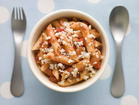 childrens food: Penne Pasta Tomato Sauce and Grated Cheese