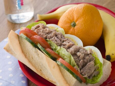 Tuna Egg and Salad Baguette with Fresh Fruit photo