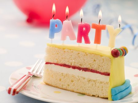 Party Candles on a Slice of Birthday Cake Stock Photo - 3443710
