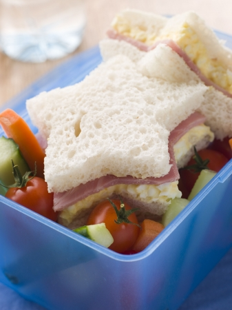 childrens meal: Star Shaped Egg Mayonnaise and Ham Sandwich with Crudities Stock Photo