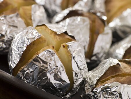 Tray of Jacket Potatoes Wrapped in Foil Stock Photo - 3444022