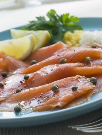 Scottish Smoked Salmon with Lemon Capers and Egg Stock Photo - 3444264