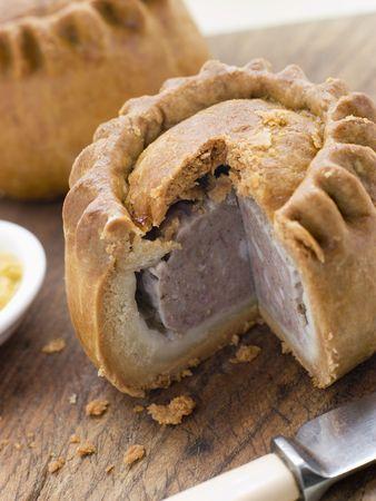 uk cuisine: Pork Pie with English Mustard Stock Photo