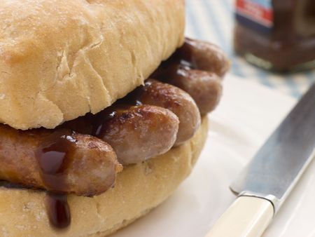 uk cuisine: Pork Sausage Crusty Roll with Brown Sauce