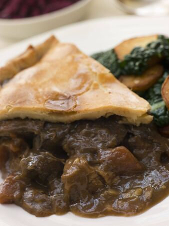 kale: Game Pie with Fried Curly Kale and Potatoes Stock Photo