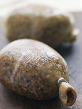 uk cuisine: Whole Haggis on a Chopping Board Stock Photo