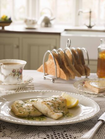 Smoked Haddock with Herb Butter and Toast Stock Photo - 3444240